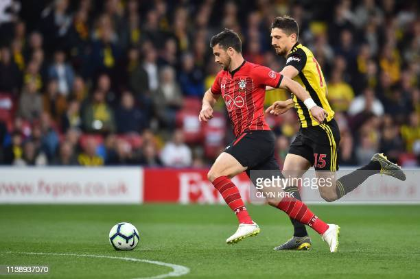 Southampton's Irish striker Shane Long runs to score the opening goal during the English Premier League football match between Watford and...
