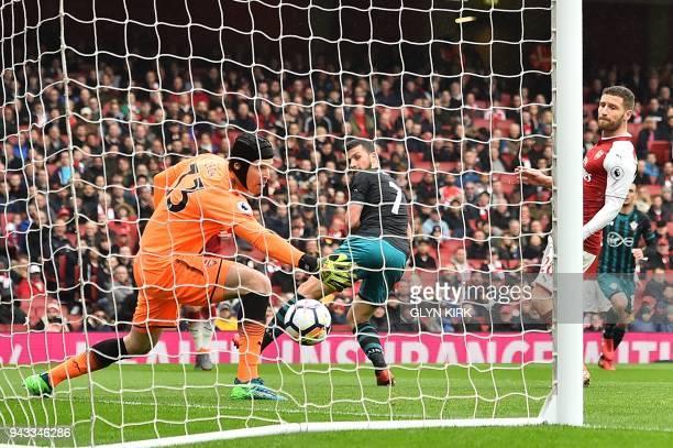 Southampton's Irish striker Shane Long scores past Arsenal's Czech goalkeeper Petr Cech and Arsenal's German defender Shkodran Mustafiduring the...