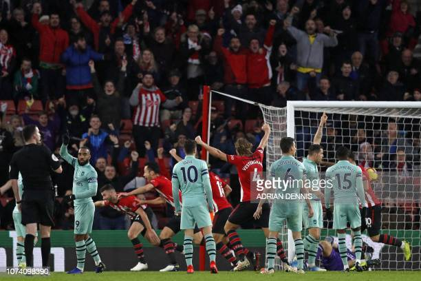 Southampton's Irish striker Shane Long starts to celebrate but his goal is disallowed for offside during the English Premier League football match...