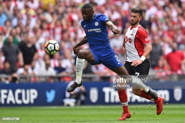 Southampton's Irish striker Shane Long vies with Chelsea's German defender Antonio Rudiger during the English FA Cup semifinal football match between...