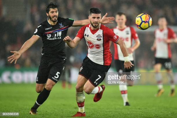 Southampton's Irish striker Shane Long vies with Crystal Palace's English defender James Tomkins during the English Premier League football match...