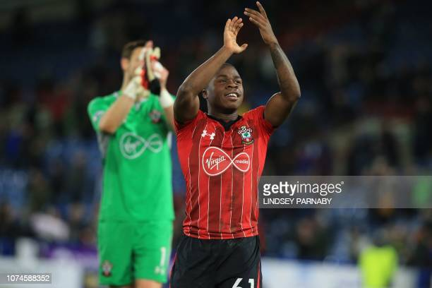 Southampton's Irishborn striker Michael Obafemi celebrates on the pitch after the English Premier League football match between Huddersfield Town and...