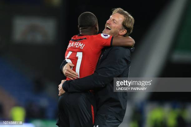 Southampton's Irishborn striker Michael Obafemi celebrates with Southampton's incoming Austrian manager Ralph Hasenhuttl on the pitch after the...