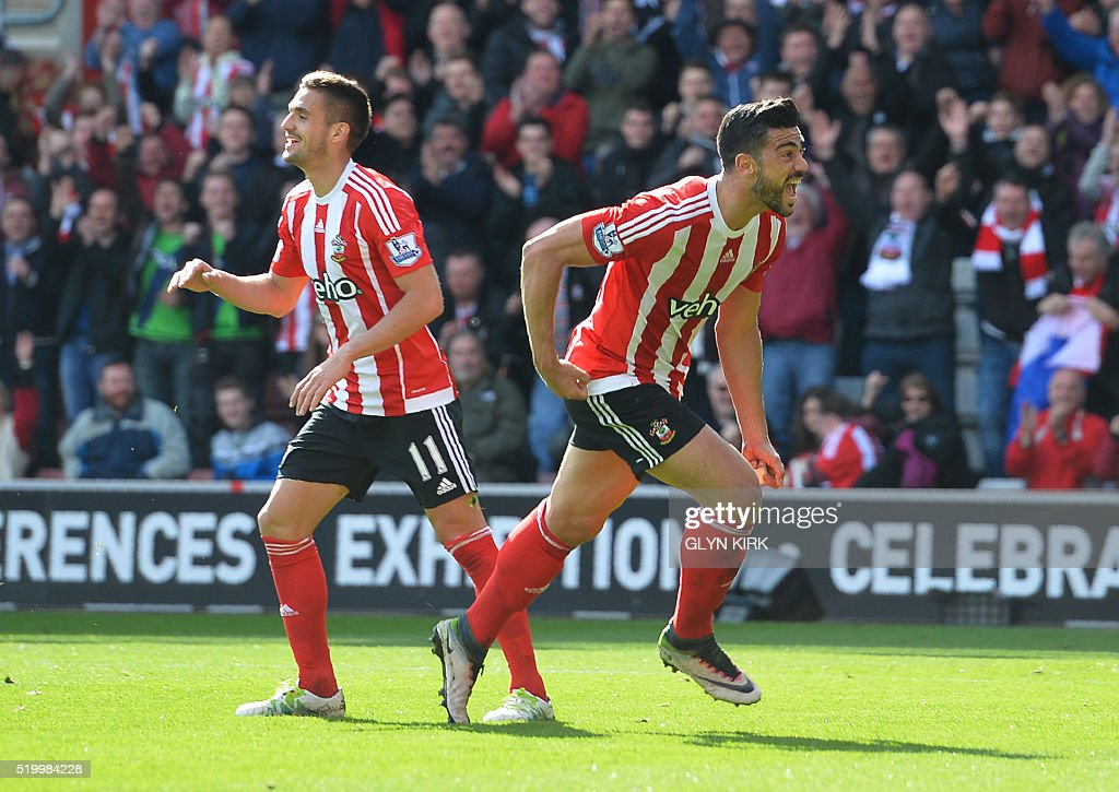 Southampton's Italian striker Graziano Pelle (R) celebrates after scoring during the English Premier League football match between Southampton and Newcastle at St Mary's Stadium in Southampton, southern England on April 9, 2016. / AFP / GLYN KIRK / RESTRICTED TO EDITORIAL USE. No use with unauthorized audio, video, data, fixture lists, club/league logos or 'live' services. Online in-match use limited to 75 images, no video emulation. No use in betting, games or single club/league/player publications. /