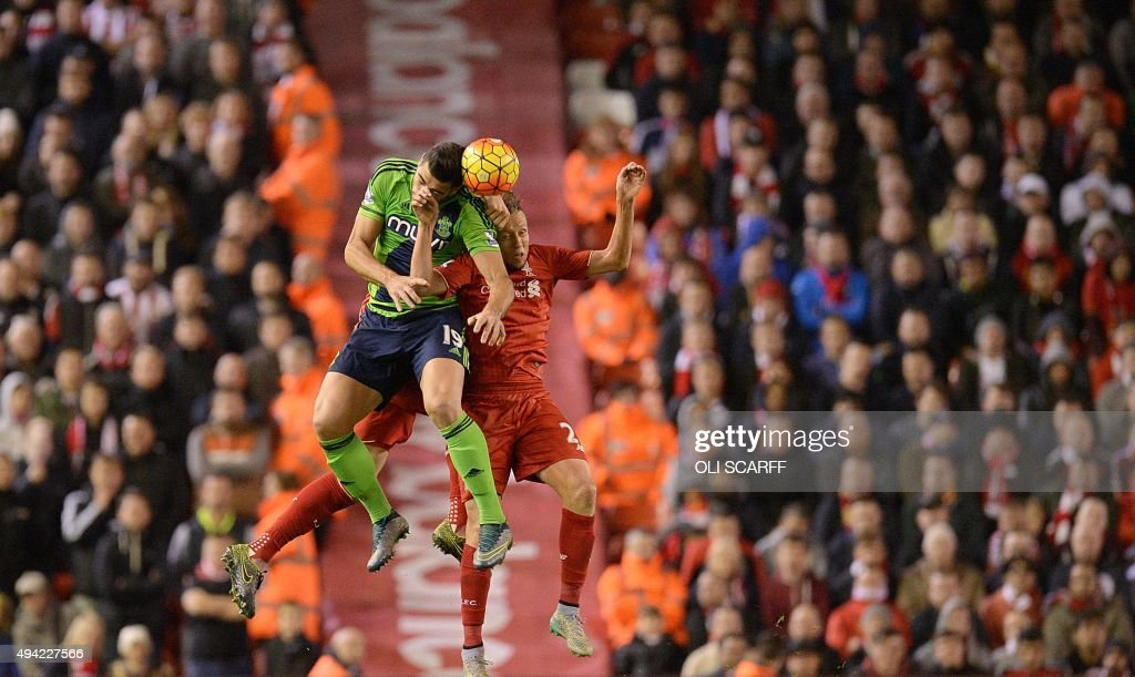 Southampton's Italian striker Graziano Pelle (L) vies with Liverpool's Brazilian midfielder Lucas Leiva during the English Premier League football match between Liverpool and Southampton at Anfield stadium in Liverpool, north west England on October 25, 2015. The game finished 1-1. AFP PHOTO / OLI SCARFF USE. No use with unauthorized audio, video, data, fixture lists, club/league logos or 'live' services. Online in-match use limited to 75 images, no video emulation. No use in betting, games or single club/league/player publications. /
