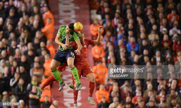 Southampton's Italian striker Graziano Pelle vies with Liverpool's Brazilian midfielder Lucas Leiva during the English Premier League football match...
