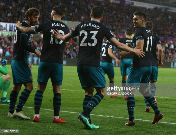 Southampton's Italian striker Manolo Gabbiadini celebrates scoring his team's first goal during the English Premier League football match between...