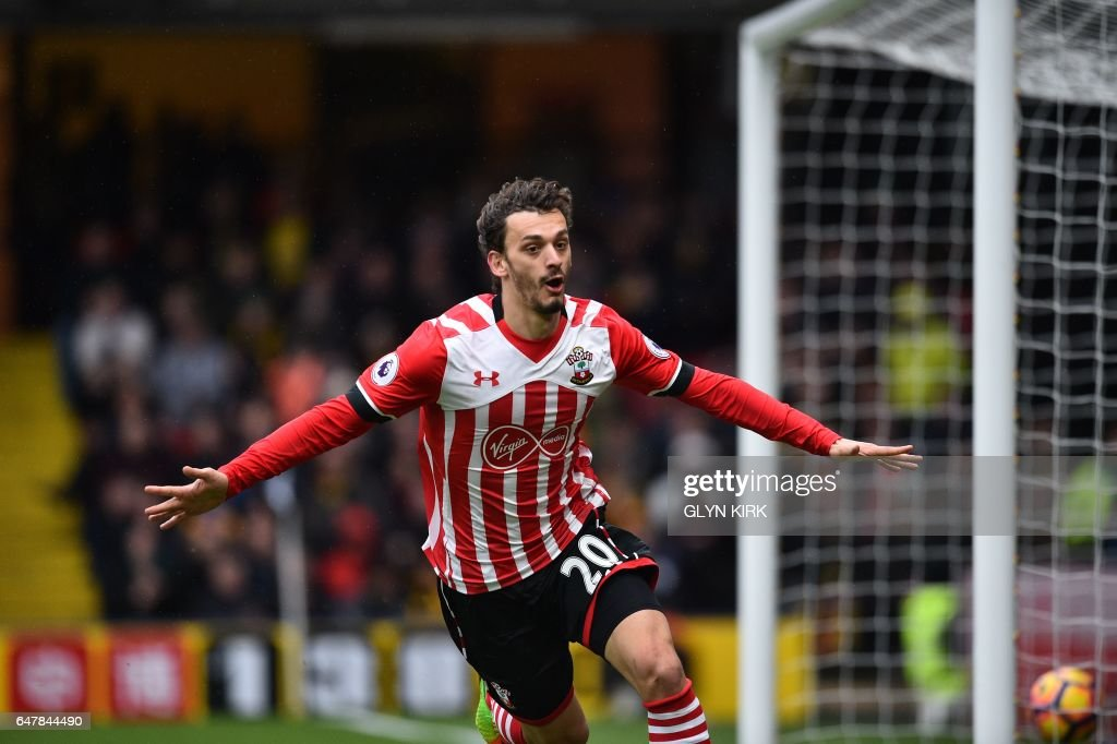 Southampton's Italian striker Manolo Gabbiadini celebrates scoring their fourth goal during the English Premier League football match between Watford and Southampton at Vicarage Road Stadium in Watford, north of London on March 4, 2017. / AFP PHOTO / Glyn KIRK / RESTRICTED TO EDITORIAL USE. No use with unauthorized audio, video, data, fixture lists, club/league logos or 'live' services. Online in-match use limited to 75 images, no video emulation. No use in betting, games or single club/league/player publications. /
