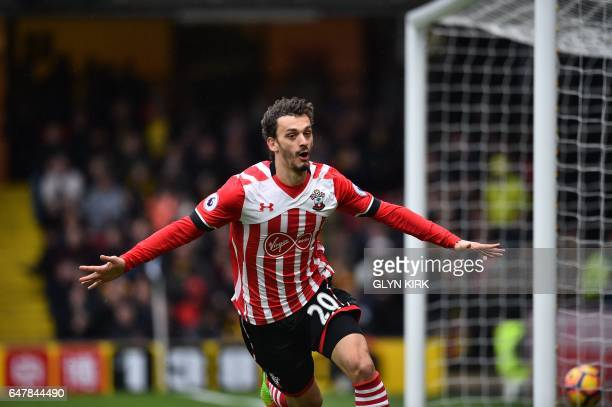 Southampton's Italian striker Manolo Gabbiadini celebrates scoring their fourth goal during the English Premier League football match between Watford...
