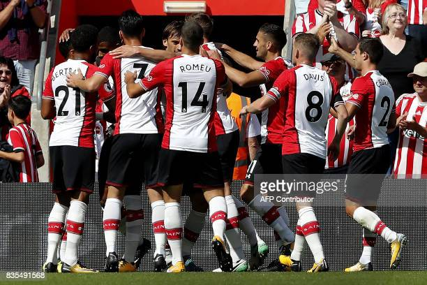 Southampton's Italian striker Manolo Gabbiadini celebrates with teammates scoring his team's first goal during the English Premier League football...