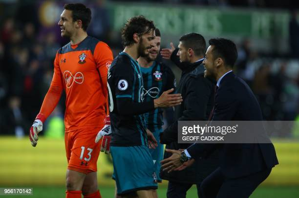 Southampton's Italian striker Manolo Gabbiadini reacts following the English Premier League football match between Swansea City and Southampton at...
