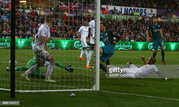 Southampton's Italian striker Manolo Gabbiadini scores his team's first goal during the English Premier League football match between Swansea City...