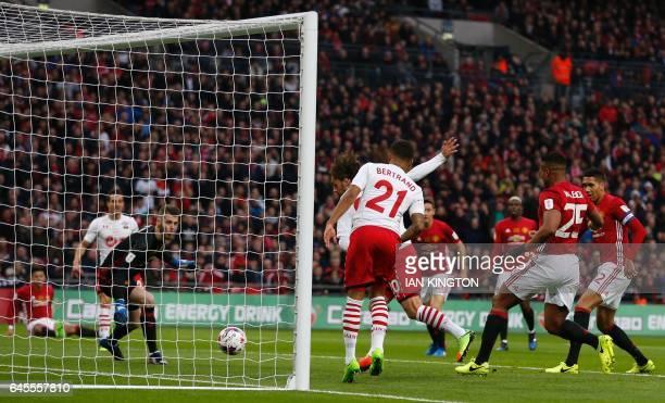 Southampton's Italian striker Manolo Gabbiadini slots the ball past Manchester United's Spanish goalkeeper David de Gea but the goal is disallowed...