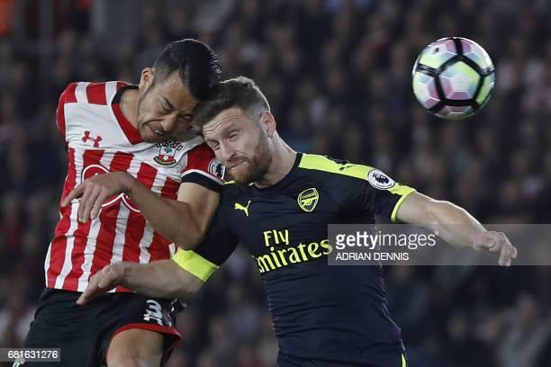 Southampton's Japanese defender Maya Yoshida and Arsenal's German defender Shkodran Mustafi clash heads during the English Premier League football...