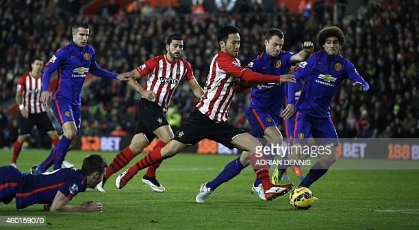 Southampton's Japanese defender Maya Yoshida battles in the area for the space for a shot against Manchester United's Northern Irish defender Jonny...