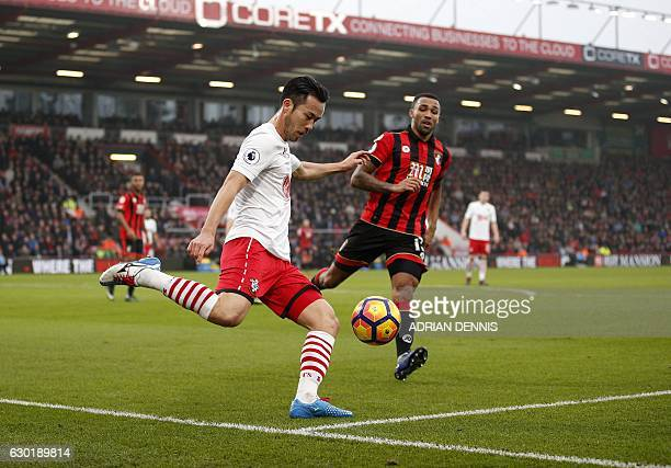 Southampton's Japanese defender Maya Yoshida clears the ball from the path of Bournemouth's English striker Callum Wilson during the English Premier...