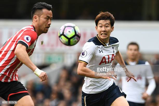 Southampton's Japanese defender Maya Yoshida vies with Tottenham Hotspur's South Korean striker Son HeungMin during the English Premier League...