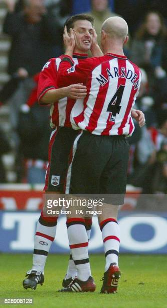 Southampton's Jason Dodd celebrates with Chris Marsden after scoring the opening goal against local rivals Portsmouth in the Barclaycard Premiership...