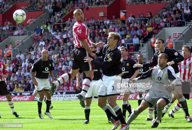 Southampton's Kevin Phillips jumps for a high ball amidst the defense of Manchester United, 31 August 2003 at Southampton's new ground during their...