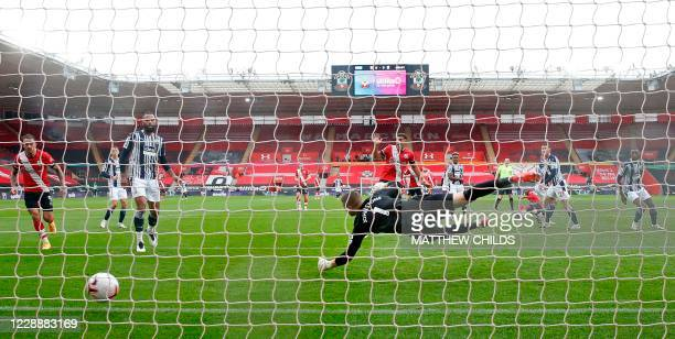 Southampton's Malian midfielder Moussa Djenepo shoots to score his team's first goal past West Bromwich Albion's English goalkeeper Sam Johnston...