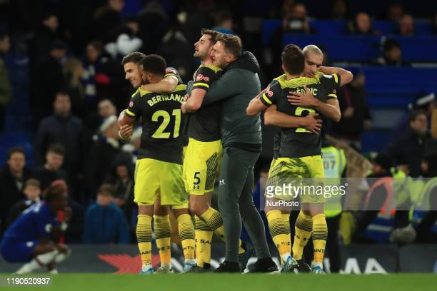 Southamptons manager Ralph Hasenhuttl celebrates his sides victory with Southamptons Jack Stephens during the Premier League match between Chelsea...