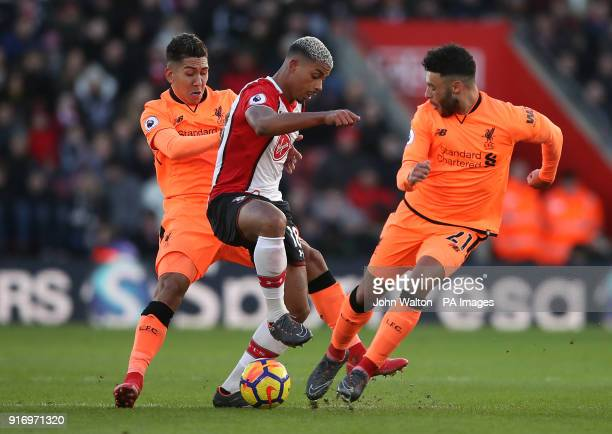 Southampton's Mario Leminaand Liverpool's Alex OxladeChamberlain battle for the ball during the Premier League match at St Mary's Stadium Southampton