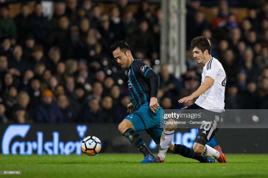 Southampton's Maya Yoshida battles for possession with Fulham's Lucas Piazon during the Emirates FA Cup Third Round match between Fulham and Southampton at Craven Cottage on January 6, 2018 in London, England.