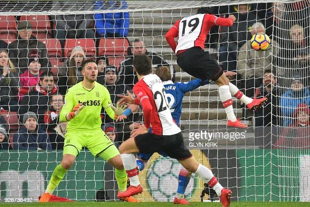 Southampton's Moroccan midfielder Sofiane Boufal misses with this headed attempt during the English Premier League football match between Southampton...