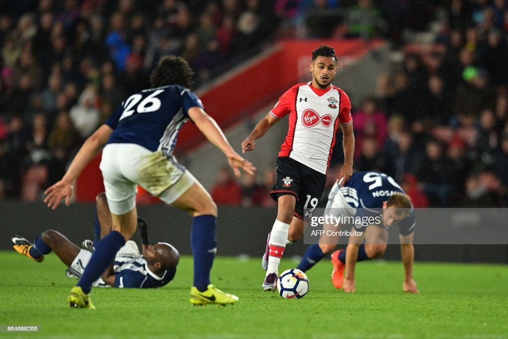 Southampton's Moroccan midfielder Sofiane Boufal (2nd R) runs past West Bromwich Albion's French-born Cameroonian defender Allan Nyom (2nd L) and West Bromwich Albion's English defender Craig Dawson (R) on his way to scoring the opening goal of the English Premier League football match between Southampton and West Bromwich Albion at St Mary's Stadium in Southampton, southern England on October 21, 2017. / AFP PHOTO / Glyn KIRK / RESTRICTED TO EDITORIAL USE. No use with unauthorized audio, video, data, fixture lists, club/league logos or 'live' services. Online in-match use limited to 75 images, no video emulation. No use in betting, games or single club/league/player publications. /
