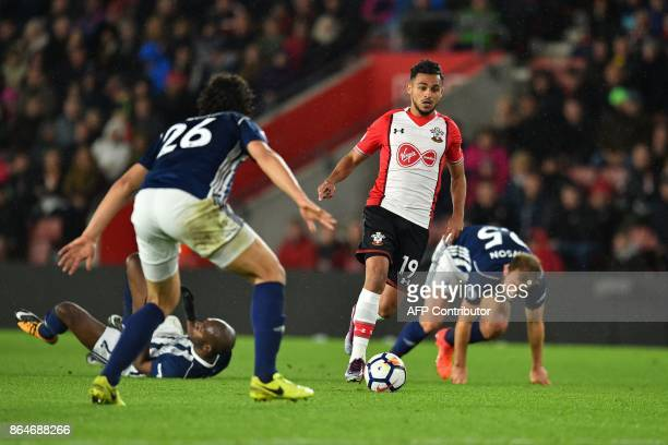 Southampton's Moroccan midfielder Sofiane Boufal runs past West Bromwich Albion's French-born Cameroonian defender Allan Nyom and West Bromwich...