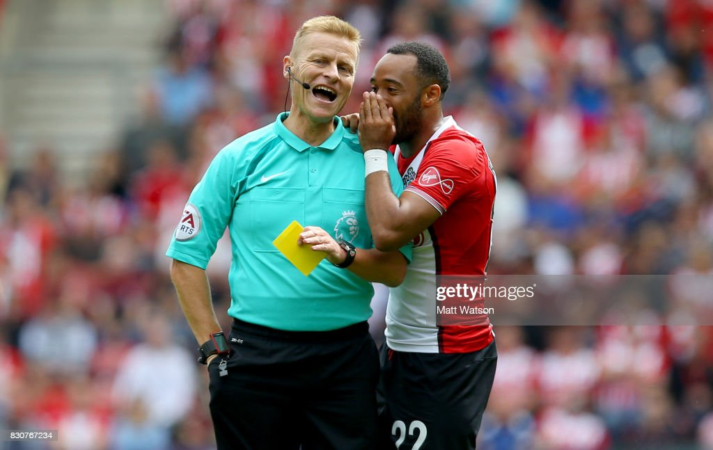 Southampton's Nathan Redmond speaks to referee Mike Jones during the Premier League match between Southampton and Swansea City at St Mary's Stadium on August 12, 2017 in Southampton, England.
