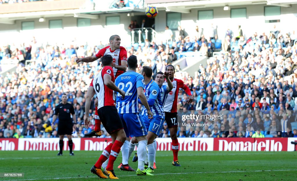 Southampton's Oriol Romeu jumps highest but cannot get on the end of a corner during the Premier League match between Brighton and Hove Albion and Southampton at the Amex Stadium on October 28, 2017 in Brighton, England.