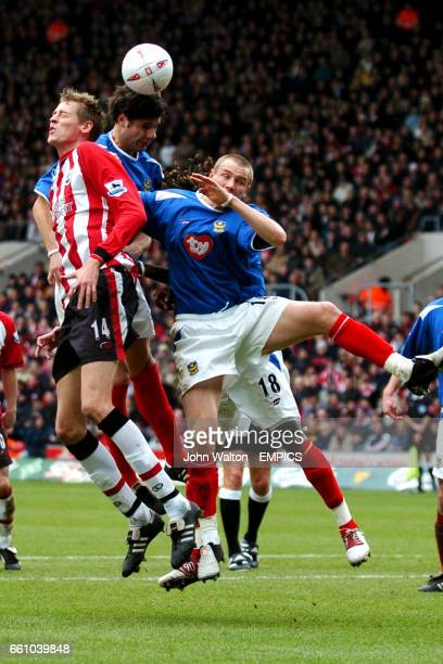 Southampton's Peter Crouch is outjumped by Portsmouth's Dejan Stefanovic