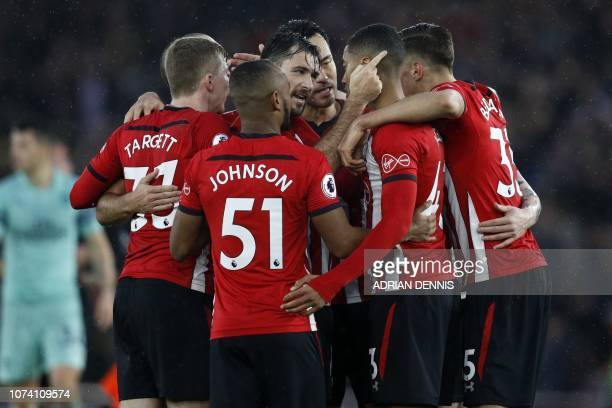 Southampton's players celebrate after the English Premier League football match between Southampton and Arsenal at St Mary's Stadium in Southampton...