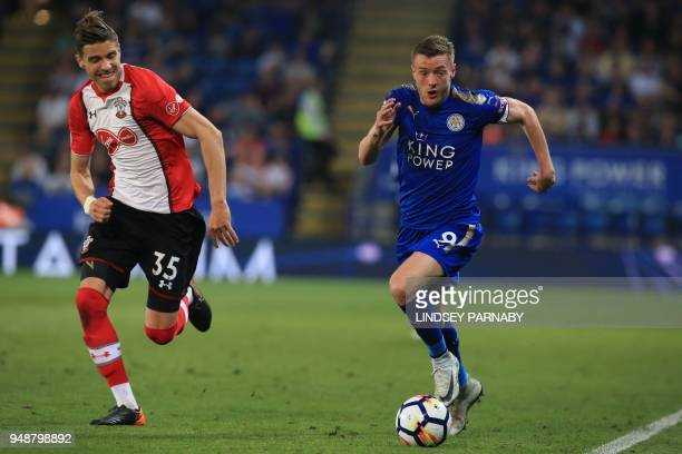 Southampton's Polish defender Jan Bednarek chases Leicester City's English striker Jamie Vardy during the English Premier League football match...