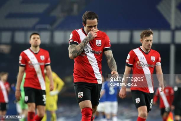 Southampton's Polish defender Jan Bednarek , Southampton's English striker Danny Ings and Southampton's English midfielder James Ward-Prowse react to...