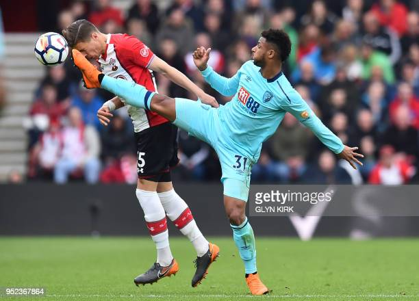 Southampton's Polish defender Jan Bednarek vies with Bournemouth's French midfielder Lys Mousset during the English Premier League football match...