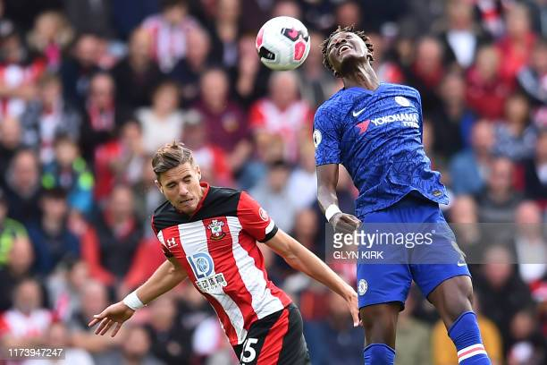 Southampton's Polish defender Jan Bednarek vies with Chelsea's English striker Tammy Abraham during the English Premier League football match between...