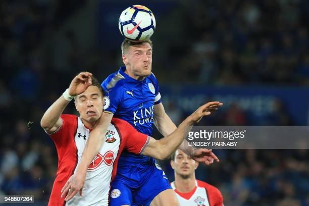Southampton's Polish defender Jan Bednarek vies with Leicester City's English striker Jamie Vardy during the English Premier League football match...