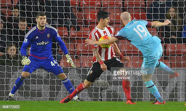 Southampton's Portuguese defender Jose Fonte vies with West Ham United's Welsh defender James Collins during the English Premier League football...
