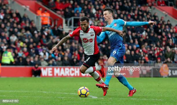 Southampton's Ryan Bertrand gets past Laurent Koscielny during the Premier League match between Southampton and Arsenal at St Mary's Stadium on...