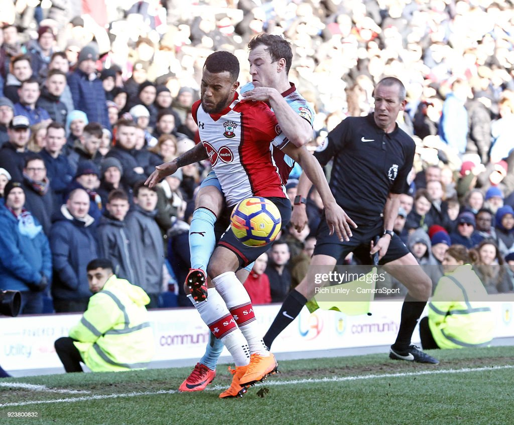 Southampton's Ryan Bertrand shields the ball from Burnley's Ashley Barnes during the Premier League match between Burnley and Southampton at Turf Moor on February 24, 2018 in Burnley, England.