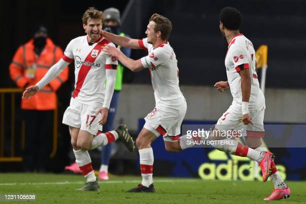 Southampton's Scottish midfielder Stuart Armstrong celebrates with teammates after scoring their second goal during the English FA Cup fifth round...