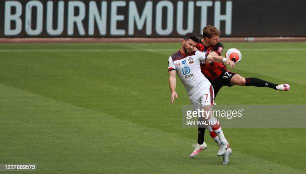 Southampton's Scottish midfielder Stuart Armstrong fights for the ball with Southampton's Irish striker Shane Long during the English Premier League...