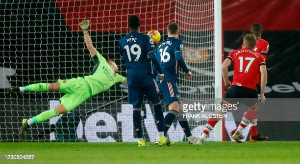 Southampton's Scottish midfielder Stuart Armstrong scores the opening goal during the English Premier League football match between Southampton and...