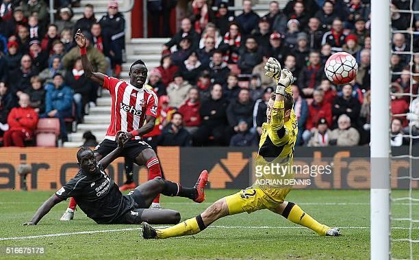 Southampton's Senegalese midfielder Sadio Mane scores his team's first goal past Liverpool's Belgian goalkeeper Simon Mignolet during the English...