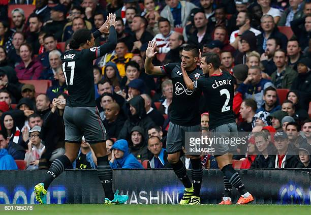 Southampton's Serbian midfielder Dusan Tadic celebrates with Southampton's Germanborn Portuguese defender Cedric Soares and Southampton's Dutch...
