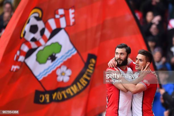 Southampton's Serbian midfielder Dusan Tadic celebrates with Southampton's English striker Charlie Austin for scoring the opening goal during the...
