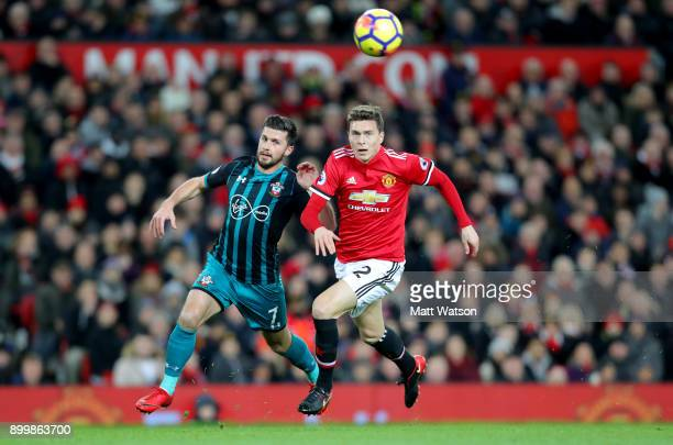 Southampton's Shane Long and Victor Lindelof of Manchester United during the Premier League match between Manchester United and Southampton at Old...