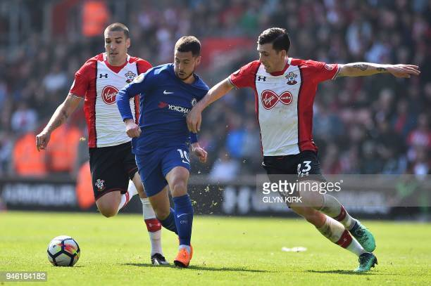 Southampton's Spanish midfielder Oriol Romeu and Southampton's Danish midfielder PierreEmile Hojbjerg battle with Chelsea's Belgian midfielder Eden...